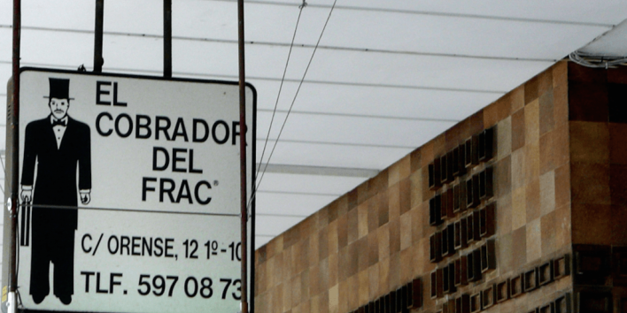 spanish debt collector's office sign