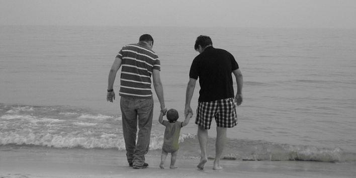 men parents baby learn walk ocean