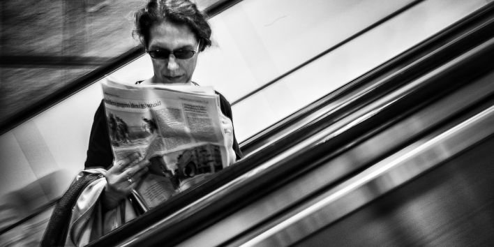 woman street paper stairs